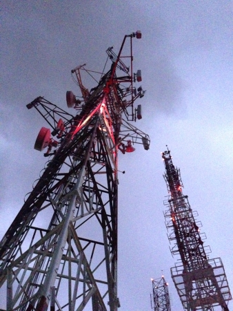 Communication towers during a thunder storm
