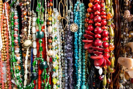 Multiples necklaces with pearls, seeds, stones and other materials. Different shapes, colors and sizes.