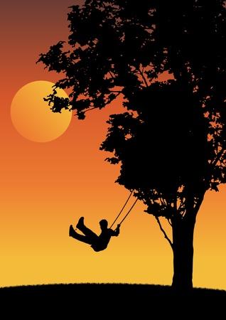 Niño en el oscilación de la puesta del sol.