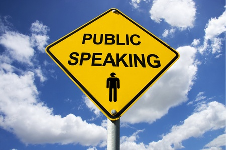 Public Speaking Sign Against A Cloudy Background photo