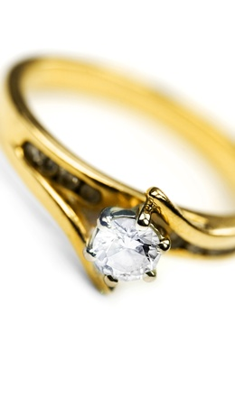 Sparkling Gold Diamond Engagement Ring Isolated White Background photo