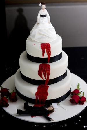 Killer Bride Wedding Cake, With A Groom Laying Dead And Slain Holding A Pre Nuptual Agreement In Hand photo