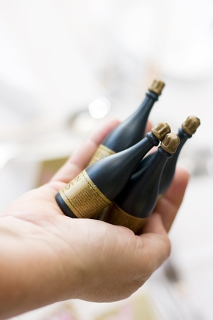Hand Holding Small Decretive Bottles Of Champaign Bubbles At A Wedding Reception Celebration Stock Photo - 11584038
