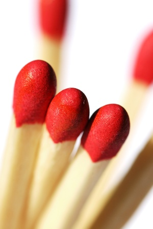 Three Red Tip Matches Ready To Be Lit Up photo