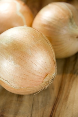 Onions Placed On A Wooden Kitchen Chopping Block photo