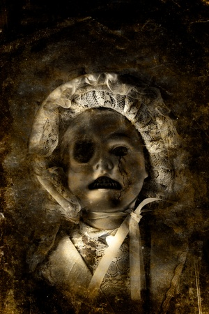 Grunge Textured Picture Of A Dark Eerie And Unhappy Porcelain Doll Crying Tears Of Cracks From One Eye In A Expression Of Desolation And Misery Stock Photo - 11584115