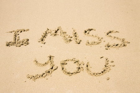Words I Miss You Hand Written In The Sand photo