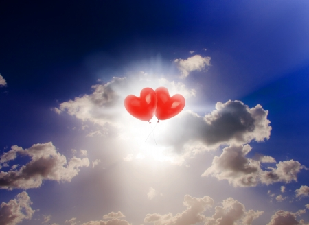 Sky Bound Romance Picture Of Two Red Floating Love Heart Balloons Touching In Front Of A Beautiful Cloud Sunset photo