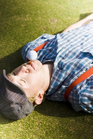 Golfer Learns The Art Of Balance While Balancing A Golf Ball And Tee In Complete Steadiness And Stability On A Golf Course Green In A Sports Conceptual Stock Photo - 11584984