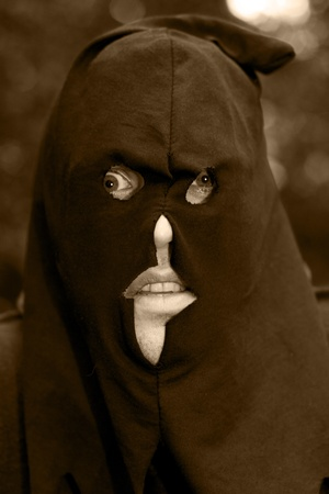 The Face Of A Historical Headsman Wearing A Black Hooded Mask Over His Face In A Nightmare Portrait Stock Photo - 11584663