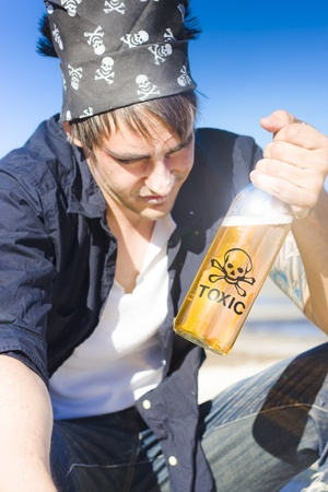Seaman Pirate Looks Down With A Distasteful Stare At A Bottle Of Alcoholic Toxic Rum In Hand In A Unhealthy Lifestyle Substance Abuse Concept photo