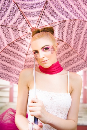 Gorgeous Female Fashion Glamour Model Wearing Scarf Tutu And Lace Makeup While Holding A Pink Umbrella Outdoors Stock Photo - 11590226