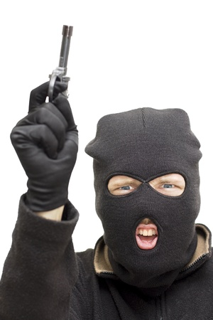 Studio Image Of A Balaclava Wearing Bandit Pointing His Gun Skywards During An Armed Holdup Stock Photo - 11584279