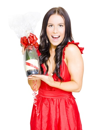 Happy Attractive Young Woman With Smile Celebrating A Victory Of Success While Holding A Wrapped Up Champagne Bottle Gift With Red Ribbon On White Background photo