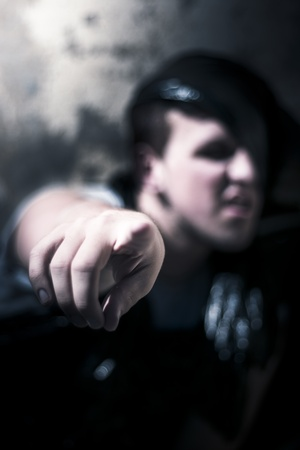 Mad Man Hiding In The Shadows Of Darkness Points Out In A Scary It Was You Horror Portrait Stock Photo - 11589738