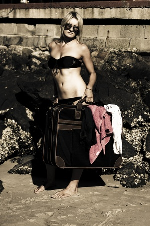 Sepia Tone Grungy Image Of A Gorgeous Person Carrying And Strolling With Holiday Travel Luggage While On A Journey To A Vintage Vacation Stock Photo - 11589946