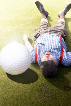 Injured Golfer Gets Hit And Knocked On To His Back By An Enormous Golf Ball In A Sport Injury Of Hilarious Proportions Titled Golfer Didnt See That One Coming Stock Photo - 11589939