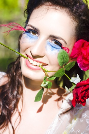 Love Struck Woman Smiling With A Floral Rose Flower Stem In Her Teeth In A Gorgeous Face Portrait Of Pure Love Devotion And Romance In Love At First Bite Stock Photo - 11584519