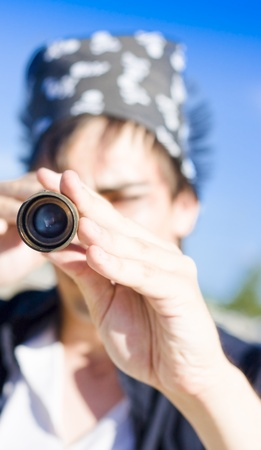 Face Front On View Of A Naval Sea Pirate Watching And Seeking Through A Navigation Spyglass In A Quest To View Future Horizons photo