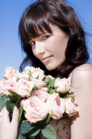 Woman With Love In Her Eyes Holds A Beautiful Bunch Of Flowers In A Pink Rose Romance photo