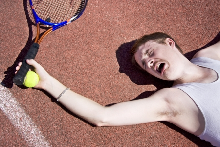 Clay Court Tennis Player Cries Out For Medical Attention With An Injured Elbow Stock Photo - 11590238