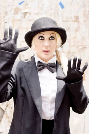 Female Performer Entertains Through Feeling And Gesturing Whilst Performing The Great Wall Of Mime Stock Photo - 11589901