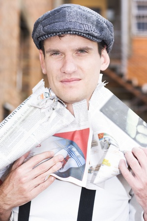 Man Standing In The Streets Puts A Newspaper On His Head To Get The Heads Up On The Latest Breaking Fashion News Stock Photo - 11589866