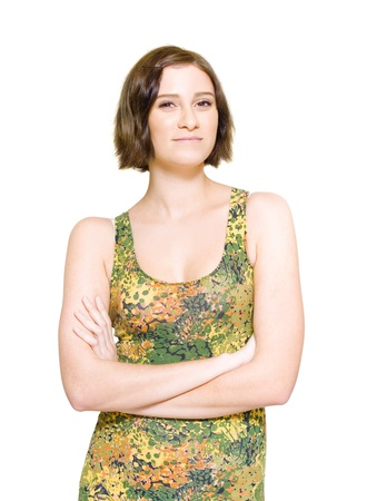 Relaxed Woman Wearing Colorful Floral Dress Folding Arms With A Look Of Hope In Her Expression And A Spring In Her Step, Isolate Studio Photo Over White Background Stock Photo - 11589798