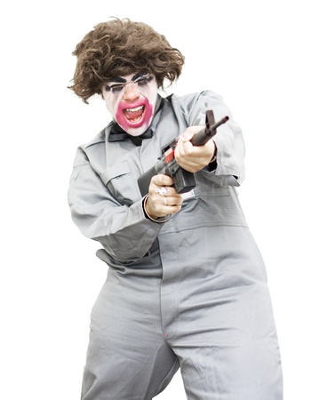 Female Psycho Killer Going Berserk Screaming Out While Firing Off Rounds From A Machine Gun – Isolated On A White Background Stock Photo - 11584173