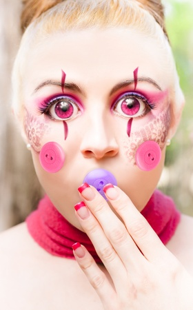 Unusual And Different Image Of A Doll In Silence With A Button Mouth, In A Button It Concept Depicting Quiet Silence And Hush Stock Photo - 11589795