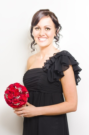 Attractive And Happy Smiling Bridesmaid With Black Dress And Up-Do Holding Red Rose Bouquet With Pretty And Flashy Smile Isolate Against White Background Stock Photo - 11590172