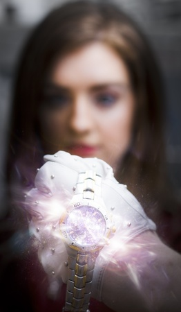 Closeup On The Face Of An Exploding Wrist Watch Draped Across The Back Of A Gloved Hand, With The Blurred Image Of A Young Woman In The Background Stock Photo - 11589787