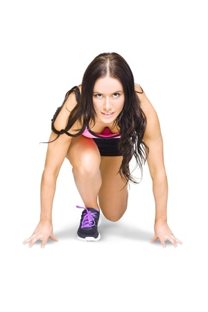 Isolated Female Marathon Runner Crouching Down At Starting Blocks During A Track And Field Running Race Etched On A White Background With Room For Copy Space photo