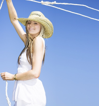 A Outdoor Farm Girl Lassos A Rope In The Blue Sky Breeze Catching A Grab Of The Farmyard Life photo