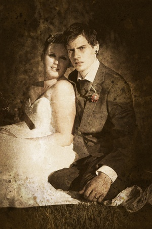 Grungy Faded Textured Vintage Wedding Photograph Of A Endearing Couple Embrace Each Others Presence In A Image Depicting Olden Day Nostalgia And Passing Time Stock Photo - 11590187