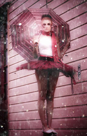 Dancing In The Rain Image Of A Ballet Dancer Standing In A Downpour Of Falling Rain Holding An Umbrella Or Parasol In A Image Titled Water Dance photo
