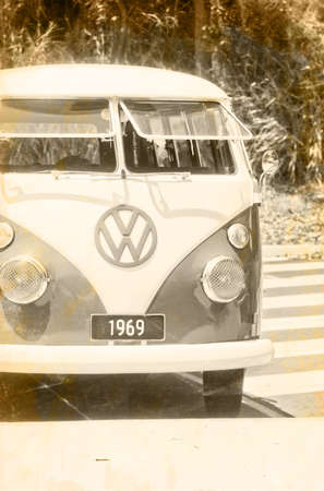 Old Grunge Photograph In Sepia Of A Green Type 2 Volkswagon Kombi Van Parked At A Beach Carpark In 1969 The Year Of Woodstock The Moon Landing And Free Love