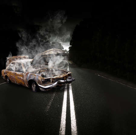Rusty Overheated And Broken Down Vehicle Wreck Steaming Up Clouds Of Smoke And Fumes On The Side Of A Atmospheric Road In A Roadside Assistance Conceptual photo
