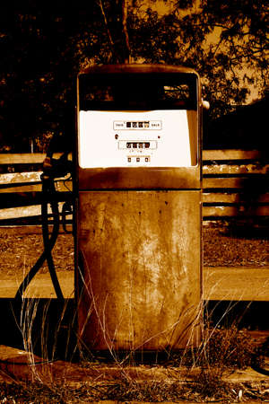 Sepia Toned Rusty Old Petrol Bowser At A Old Abandoned Outback Petrol Station photo