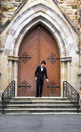 Well Dressed Man Standing At The Entrance Of A Church Door For This Is His Stairway Into Heaven photo