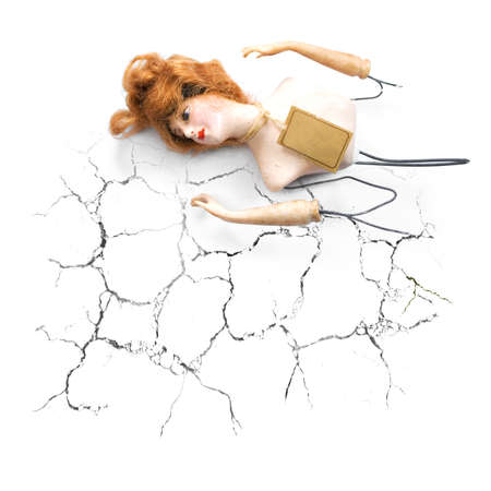 Inspired By Heartbreak A Broken Doll Lays Abondoned And Lost After A Cracked And Broken Romance Stock Photo - 11589988