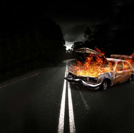 Gutted Burning Car Shell Set Ablaze With Fire And Flames Engulfing The Vehicles Cabin And Engine Bay In A Creative And Explosive Car Bomb Conceptual photo