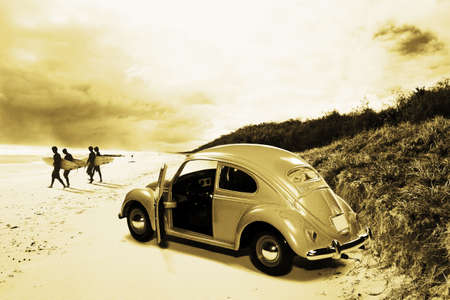 Vintage Surfing Scene With Four Surf Boarding Mates Walking From Their Sixties Beach Car To The Ocean Shoreline