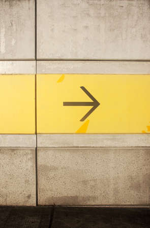 Directional Arrow Points Right On The Direction Wall Stock Photo - 11591248