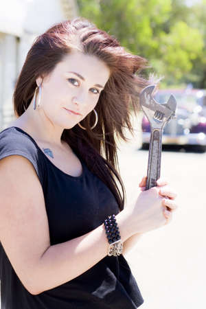 Girl holding wrench Stock Photo - 12864084