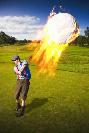 An Inferno Of Fire Follows An Airborne Golf Ball Just After Being Hit By A Golfer Man In A Hot Shot Golfing Concept photo
