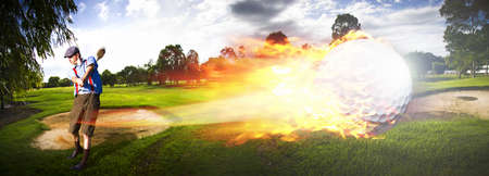 Sport Action Landscape Panoramic Of A Golf Player Hitting A Fast Paced Flaming Golf Ball Through The Golf Course Air In A Motion Of Flames And Fire photo