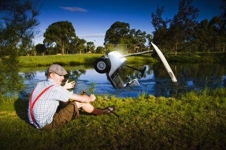 Distressed And Unhappy Golfer With Bad Driving Skills Crashes The Golf Buggy Into A Golf Course Lake In A Funny Image Representing Golf Problems And Issues photo