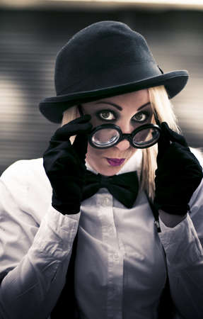 Undercover Secret Agent Look Over Her Glasses With A Sexy Stare During An Clandestine Covert Operation Of Espionage Stock Photo - 12864127