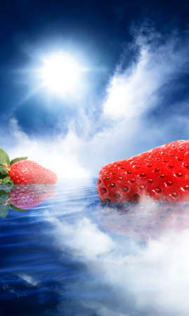 Surrealism Photo Of Two Strawberries Floating Along A Calm Water Landscape Scene Inspired By Medieval Symbolism Of The Strawberry Meaning Perfection Stock Photo - 11591274
